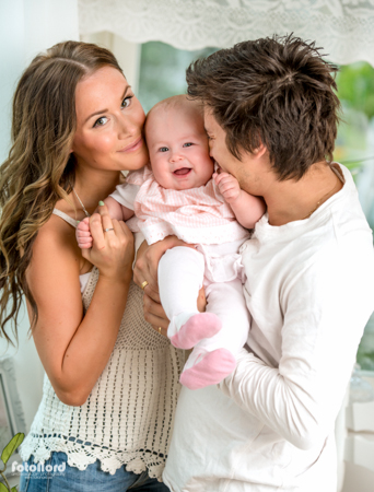 young family with a baby girl