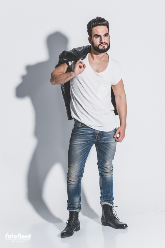 modern bearded male wearing jeans and a leather jacket