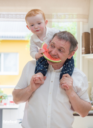 Father and son eating watermelon