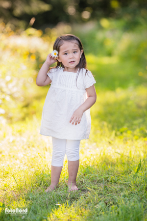 a cute young girl in a summer park