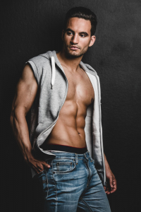 fit young man in hoodie