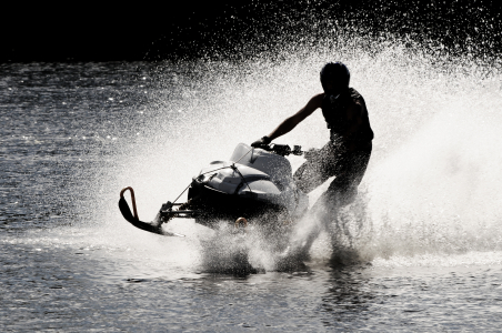 Snowmobile on open water